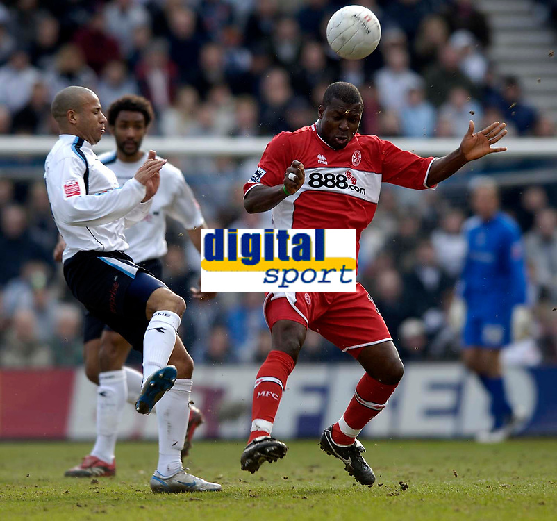 Photo: Jed Wee.<br /> Preston North End v Middlesbrough. The FA Cup. 19/02/2006.<br /> <br /> Middlesbrough's Yakubu (R) wins the ball from Preston's Tye Mears.
