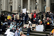 Protesters holding up signs on the steps of Parliament during the protest on 06 June, 2020 in Melbourne, Australia. This event was organised to rally against aboriginal deaths in custody in Australia as well as in unity with protests across the United States following the killing of an unarmed black man George Floyd at the hands of a police officer in Minneapolis, Minnesota. (Photo by Brett Keating/ Speed Media)