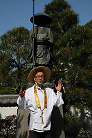 "Henro on the Shikoku Pilgrimage - the Pilgrimage is a trail of 88 temples on Shikoku and is believed that all 88 temples were visited by the famous Buddhist monk Kukai, founder of the Shingon school, who was born at Zentsuji Temple in 774.  To complete the pilgrimage, it is not necessary to visit the temples in order.  The pilgrimage is traditionally completed on foot, but modern pilgrims use cars, taxis, buses, bicycles or motorcycles. The walking course is approximately 1200km long and can take anywhere from 30 to 60 days to complete. ""Henro"" is the Japanese word for pilgrim - they are recognizable by their white clothing,  special walking sticks with bells and sedge hats."