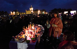 © Licensed to London News Pictures.22/08/15<br /> Castle Howard, North Yorkshire, UK. <br /> <br /> Hundreds of people enjoy candlelit picnics as night falls during the 25th anniversary of the Castle Howard Proms event near York. The theme of the event this year is a commemoration of the 75th anniversary of the Battle of Britain and the 70th anniversary of VE day and brings an evening of classic musical favourites celebrating Britishness to the lawns of Castle Howard.<br /> <br /> Photo credit : Ian Forsyth/LNP