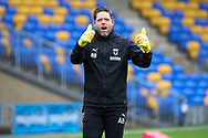 AFC Wimbledon goalkeeping coach Ashley Bayes giving thumbs up whilst warming up during the EFL Sky Bet League 1 match between AFC Wimbledon and Milton Keynes Dons at Plough Lane, London, United Kingdom on 30 January 2021.