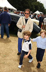 "LORD LINLEY and his son the HON.CHARLES ARMSTRONG-JONES at the Goodwood Festival of Speed on 9th July 2006.  Cartier sponsored the ""Style Et Luxe' for vintage cars on the final day of this annual event at Goodwood House, West Sussex and hosted a lunch.<br />