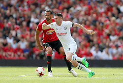 Manchester United's Rio Ferdinand (left) and Carrick All Stars' Robbie Keane battle for the ball during Michael Carrick's Testimonial match at Old Trafford, Manchester.