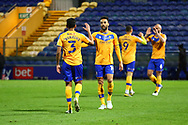 James Perch (14) of Mansfield Town and Malvind Benning (3) of Mansfield Town during the EFL Sky Bet League 2 match between Mansfield Town and Harrogate Town at the One Call Stadium, Mansfield, England on 24 November 2020.