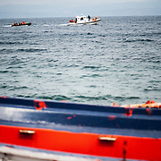 A Portuguese coast guard vessel towing a dinghy with around 50 refugees at Skala Sykamias, Lesvos, Greece