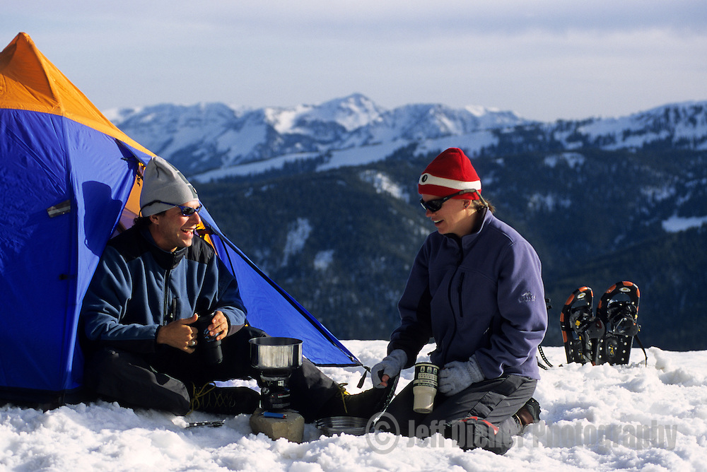A young couple winter camping in Jackson Hole, Wyoming.