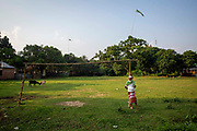 An elderly man stands next to a football goal on a playing field in Savar Union district on the 30th of September 2018 in Dhaka, Bangladesh.