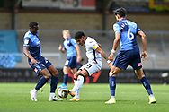 Swansea City midfielder Morgan Gibbs-White (11) and Wycombe Wanderers Jake Bidwell (24) during the EFL Sky Bet Championship match between Wycombe Wanderers and Swansea City at Adams Park, High Wycombe, England on 26 September 2020.