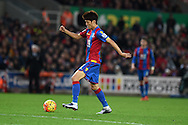 Lee Chung-Yong of Crystal Palace makes a break before scoring his late goal. .Barclays Premier league match, Stoke city v Crystal Palace at the Britannia Stadium in Stoke on Trent, Staffs on Saturday 19th December 2015.<br /> pic by Andrew Orchard, Andrew Orchard sports photography.