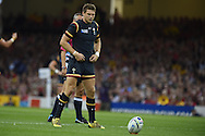 Dan Biggar of Wales goes through all his trademark preparations and then kicks a conversion. Rugby World Cup 2015 pool A match, Wales v Fiji at the Millennium Stadium in Cardiff, South Wales  on Thursday 1st October 2015.<br /> pic by  Andrew Orchard, Andrew Orchard sports photography.