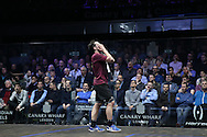 Paul Coll of New Zealand (wearing a Maroon shirt) dejected after losing another game. Canary Wharf Squash Classic 2016 , day two at the East Wintergarden in Canary Wharf , London on Tuesday 8th March 2016.<br /> pic by John Patrick Fletcher, Andrew Orchard sports photography.