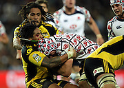 Ma'a Nonu makes the tackle on Ben Mowen<br />Super 14 rugby union match, Waratahs vs Hurricanes, Sydney, Australia. <br />Saturday 14 May 2010. Photo: Paul Seiser/PHOTOSPORT