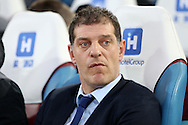 West Ham United manager Slaven Bilic looks on from the dugout before k/o. Barclays Premier league match, West Ham Utd v Stoke city at the Boleyn Ground, Upton Park  in London on Saturday 12th December 2015.<br /> pic by John Patrick Fletcher, Andrew Orchard sports photography.