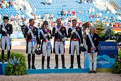 GRIFFITH Carline (Chef d´Equipe), DUJARDIN Charlotte (GBR), FAURIE Emile (GBR), HESTER Carl (GBR), WILTON Spencer (GBR)<br /> Tryon - FEI World Equestrian Games™ 2018<br /> Siegerehrung<br /> Grand Prix de Dressage Teamwertung und Einzelqualifikation<br /> 13. September 2018<br /> © www.sportfotos-lafrentz.de/Stefan Lafrentz