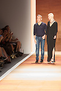 Desinger Cesar Galindo and a model on the runway at the end of his show.