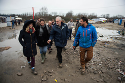 © Licensed to London News Pictures. 23/01/2016. Calais, France. Leader of the Labour Party JEREMY CORBYN (centre) visits the camp known as the 'Jungle' in Calais, France, where thousands of migrants and refugees attempting to reach the UK are currently living. Photo credit: Ben Cawthra/LNP