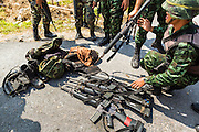 11 JULY 2013 - RAMAN, YALA, THAILAND: Thai soldiers stack the weapons and equipment of their colleagues injured in an IED attack Thursday morning. Eight soldiers were injured when the IED exploded under a Thai Army truck carrying soldiers back to their camp after they finished a teacher protection mision. The army routinely dispatches soldiers to protect teachers and Buddhist monks, who have been targeted by Muslim insurgents as representatives of the Bangkok government. More than 5,000 people have been killed and over 9,000 hurt in more than 11,000 incidents in Thailand's three southernmost provinces and four districts of Songkhla since the insurgent violence erupted in January 2004, according to Deep South Watch, an independent research organization that monitors violence in Thailand's deep south region that borders Malaysia.    PHOTO BY JACK KURTZ