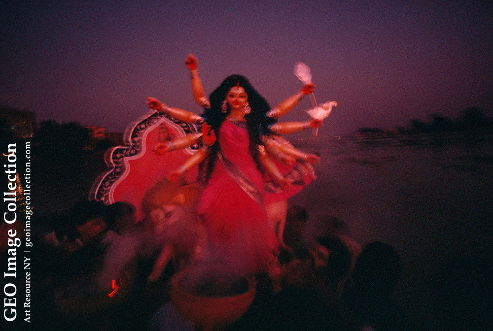 """The captions for rolls 363-372 read: """"Sunset at the Buriganga (the old Ganges) River at Saderghat ferry terminal & then the Bijoya Dashami end of the Durga Pu ja - a great Hindu festival where the Goddess Durga is thrown into the holy riv er with incense, drums & (illegible word) - all of this at Waiseghat in the heart of ol d Dhaka."""""""