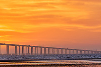 Sun rising under the Sunshine Skyway bridge from Fort De Soto Park. 4 of 4 images taken with a Fuji X-H1 camera and 200 mm f/2 OIS lens with a 1.4x teleconverter (ISO 400, 280 mm, f/16, 1/80 sec). Raw images processed with Capture One Pro and AutoPano Giga Pro.