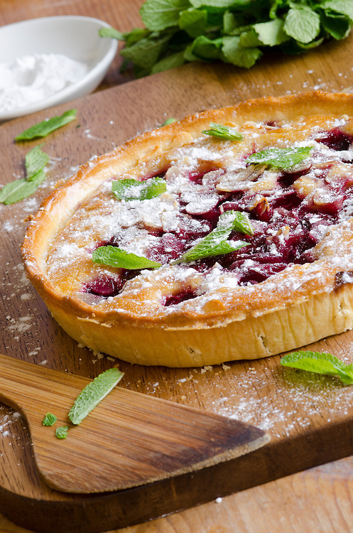 Sour cherry and almond frangipane in pastry decorated with flaked almonds