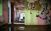 abandoned building, empty room with graffiti on the wall