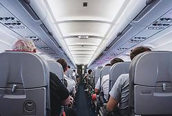 THEMENBILD - Passagiere auf ihren Sitzplätzen in der Kabine während des Flugs, aufgenommen am 17. August 2018 in Larnaka, Zypern // Passengers in their seats in the cabin during the flight, Larnaca, Zyprus on 2018/08/17. EXPA Pictures © 2018, PhotoCredit: EXPA/ JFK