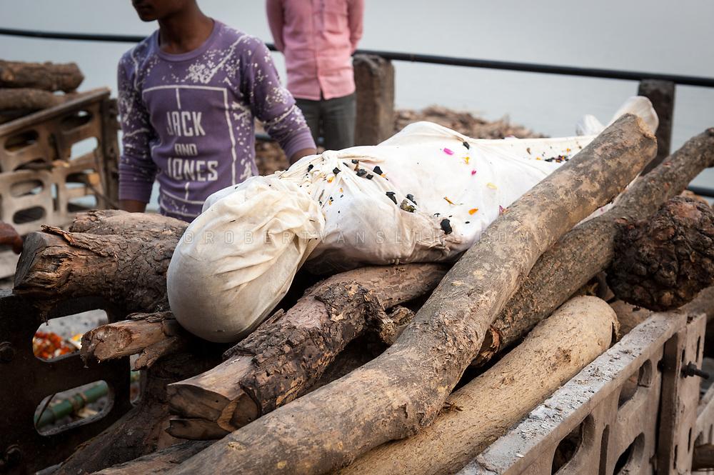 A body on a funeral pyre at Manikarnika cremation ground, Varanasi, India. Photo © robertvansluis.com