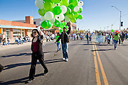 28 JANUARY 2012 - BUCKEYE, AZ:    Marchers carry balloons in the Buckeye Days parade. The Buckeye Days parade went through downtown Buckeye, AZ, an agricultural community about 45 miles west of Phoenix. The parade was one the first events to mark Arizona's centennial celebration. Arizona was admitted to the United States on Feb 14, 1912, making it the 48th state in the union. The state celebrates its 100th birthday with a series of events on Feb. 14, 2012.     PHOTO BY JACK KURTZ