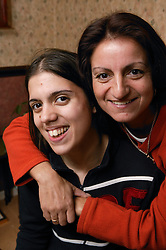 Portrait of a mother and daughter smiling,