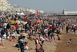 © Licensed to London News Pictures. 30/05/2021. Brighton, UK. Thousands of sun-seekers flock to the Brighton seafront on the hottest day of the year so far. According to the Met Office, a high of 24 degrees celsius is forecast for the bank holiday weekend, after weeks of rain in the South East of England.  Photo credit: Dinendra Haria/LNP