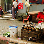 Woman with small stand in as Yangon's downtown