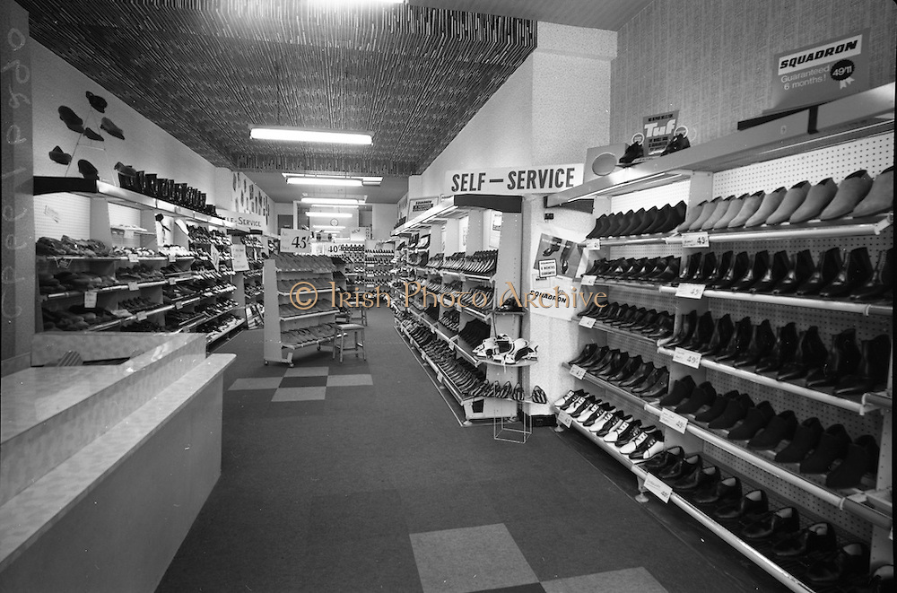 24/05/1966<br /> 05/24/1966<br /> 24 May 1966<br /> Farren's shoe Store, Parnell Street, Dublin. Interior view of the store showing the shelves of shoes, particularly the Squadron and Tuf brands.