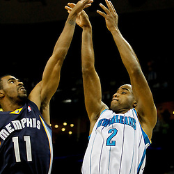 December 21, 2011; New Orleans, LA, USA; New Orleans Hornets point guard Jarrett Jack (2) shoots over Memphis Grizzlies point guard Mike Conley (11) during the first quarter of a game at the New Orleans Arena.   Mandatory Credit: Derick E. Hingle-US PRESSWIRE