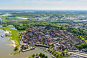 Nederland, Provincie, Plaats, 13-05-2019;<br /> Gelderland, West-Betuwe, 13-05-2019; Zaltbommel, gelegen aan rivier de Waal. Overzicht van de vestingstad met St. Maartenskerk.<br /> Zaltbommel, situated on the river Waal. Overview of the fortified city with St. Maartenskerk.<br /> <br /> luchtfoto (toeslag op standard tarieven);<br /> aerial photo (additional fee required);<br /> copyright foto/photo Siebe Swartee required);<br /> copyright foto/photo Siebe Swart