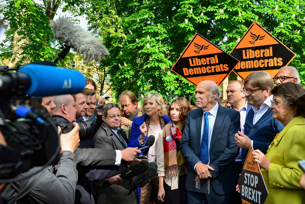 Guy Verhofstadt, Leader of the Alliance of Liberals and Democrats for Europe Party and the European Parliaments chief Brexit negotiator right speaks to the media during a European Parliament elections campaign event with Liberal Democrat leader Sir Vince Cable left and party activists before canvassing for support for their candidates in the forthcoming European elections, on 10th May 2019 in Camden, North London, England, United Kingdom. Sir Vince Cable said the partys message was to stop Brexit.