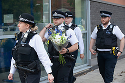 ©Licensed to London News Pictures 01/10/2020  <br /> Croydon, UK. Police officers arrive with flowers. Metropolitan Police Commissioner Cressida Dick was at Croydon Custody Centre this morning for a visit. The murder investigation continues at pace after the death of police sergeant Matt Ratana almost a week ago at the Croydon Custody Centre in South London. Photo credit:Grant Falvey/LNP
