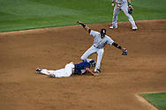 Minnesota Twins right fielder Ben Revere slides safely back into 2nd base on a pick off attempt as Chicago White Sox shortstop Alexei Ramirez covers the base on June 25, 2012 at Target Field in Minneapolis, Minnesota.  The Twins defeated the White Sox 4 to 1.  © 2012 Ben Krause