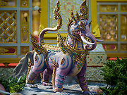 """13 DECEMBER 2017 - BANGKOK, THAILAND:  A statue of """"Thak Tho"""" a mythical beast with the body of a lion and the tusks of an elephant, at the Royal Crematorium on Sanam Luang in Bangkok. The crematorium was used for the funeral of Bhumibol Adulyadej, the Late King of Thailand. He was cremated on 26 October 2017. The crematorium is open to visitors until 31 December 2017. It will be torn down early in 2018. More than 3 million people have visited the crematorium since it opened to the public after the cremation of the King.    PHOTO BY JACK KURTZ"""
