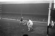 17/03/1965<br /> 03/17/1965<br /> 17 March 1965<br /> Railway Cup Hurling final  Munster v Leinster at Croke Park, Dublin. Ollie Walsh, Leinster keeper, clears the ball as Munster's S. McLoughlin closes in with Leinster's T. Neville on the ground.