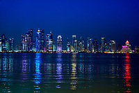 modern islamic style buildings of the corniche promenade in Doha waterfront at night