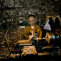 A migrant worker labors in a small motorcycle parts factory in Chongqing on Monday 19 March 2007. Chongqing is home to China's largest private motorcycle manufacturer and making motorcycles and motorcycle parts is a major industry in the city.