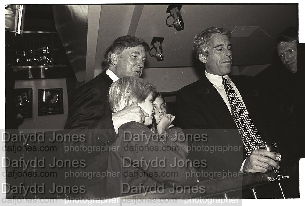 Eric Trump,, Ivanka Trump, Donald Trump, Jeffrey Epstein, Harley Davidson Cafe opening. Manhattan. 1993.