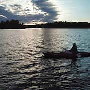Dan paddling a kayak on Island Lake, Minnesota.