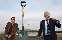 """© Licensed to London News Pictures. 23/02/2012. Wallington, Surrey. L-R: Seb Coe and Boris Johnson in front of the world's biggest spade. The Mayor of London, Boris Johnson and LOCOG Chairman Sebastian Coe today, 23 February 2012, showed off the benefits of urban food growing as they launched """"The Big Dig"""" volunteer gardening weekend (16-17 March). This is all in support of Capital Growth, a scheme to create 2,012 community food growing spaces by the end of 2012.  Photo credit: Bettina Strenske/LNP"""