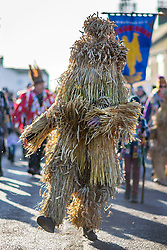 © Licensed to London News Pictures. 18/01/2020. Whittlesey UK. The 41st Whittlesey Straw Bear Festival is taking place this weekend. In times past when starvation bit deep the ploughmen of the area where drawn to towns like Whittlesey, They knocked on doors begging for food & disguised their shame by blackening their faces with soot. In Whittlesey it was the custom on the Tuesday following Plough Monday to dress one of the confraternity of the plough in straw and call him a Straw Bear. The bear was then taken around town to entertain the folk who on the previous day had subscribed to the rustics, a spread of beer, tobacco & beef. The bear was made to dance in front of houses & gifts of money, beer & food was expected. Photo credit: Andrew McCaren/LNP