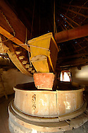 The grinding mechanism of the Folklore Museum  Bonis windmill. Mykonos Upper Chora. Cyclades Islands, Greece