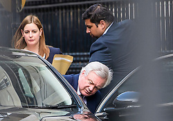 """© Licensed to London News Pictures. 30/03/2017. London, UK. Brexit Secretary David Davis gets in to a car as he leaves his office in Downing Street for Parliament to  to make a statement on the """"great repeal bill"""". Photo credit: Ben Cawthra/LNP"""