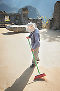 Archaeologist maintaining Machu Picchu, Cusco Region, Urubamba Province, Machupicchu District in Peru, South America