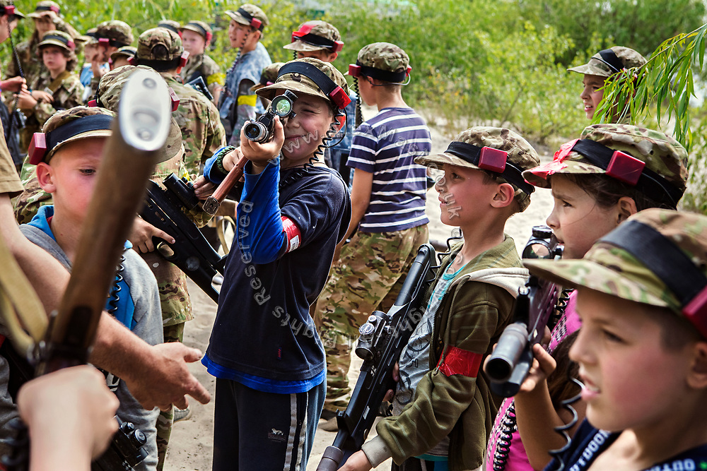 Youngsters participating to the ultra-nationalistic Azovets children's camp are testing their laser-guns ahead of a teams battle, on the banks of the Dnieper river, in Kiev, Ukraine's capital.