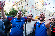 Moscow, Russia, 16/06/2018.<br /> A Russian celebrates with two Iceland supporters after their draw with Argentina during the 2018 FIFA World Cup.